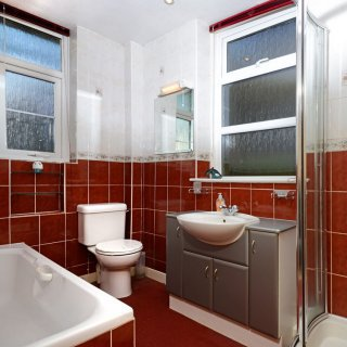 The ground floor bathroom provides a bath, shower cubicle, wash basin and toilet.