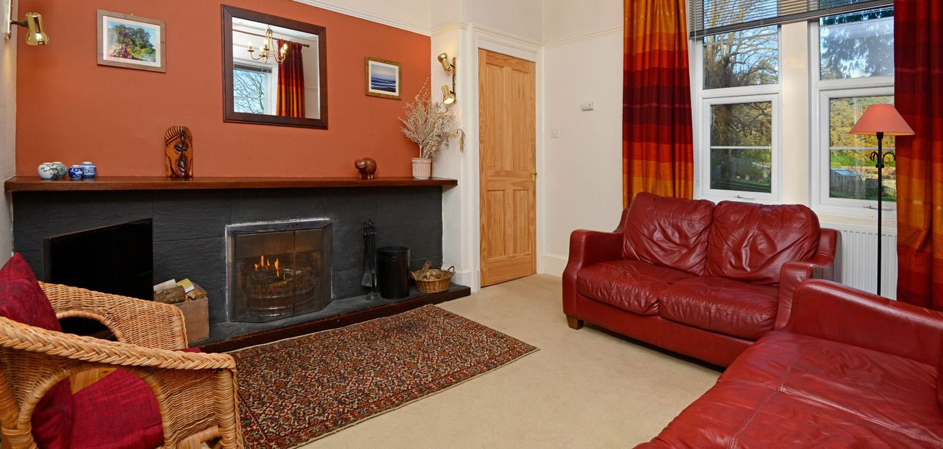 The sitting room has a cozy open fire; there is also central heating.