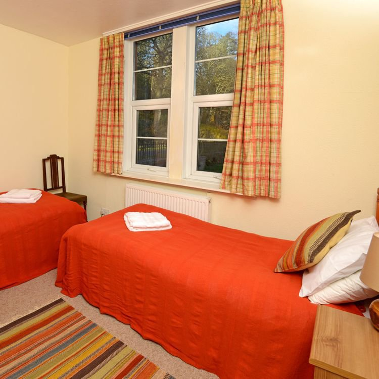 The twin bedroom on the ground floor affords views of the Estate.