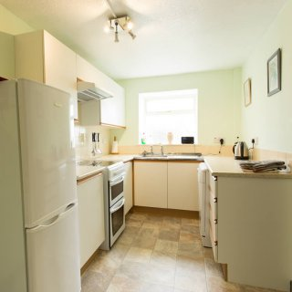 The well appointed kitchen has a cooker, microwave & dishwasher