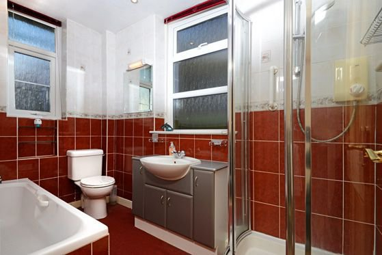The bathroom is downstairs and has a separate shower cubicle.