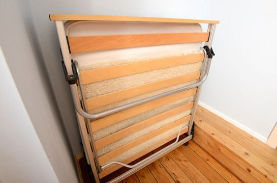 The twin bedroom can be made into triple using this fold-out full size bed.