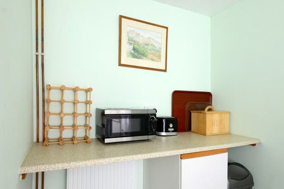 The kitchen contains all you need for self-catering in your holiday cottage.