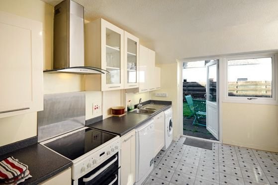 The well equipped kitchen opens directly onto the enclosed rear garden.