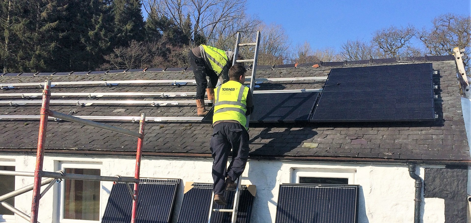 Installing solar panels at Kirkennan Estate Holiday Cottages
