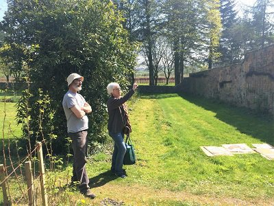 Helen and Chris discussing the installation of the garden mosaic at Kirkennan